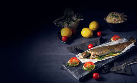 baked trout with herb filling and tomatoes Stockfoto