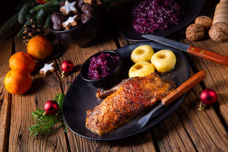 Roast goose with baked apples, red cabbage and dumplings