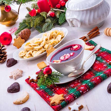 Barszcz (beetroot soup) with small pierogi Stock Photo