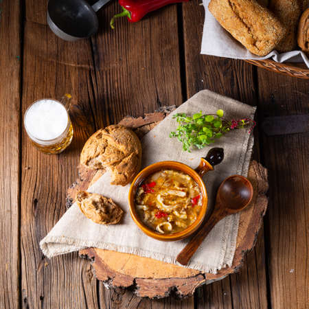 Spicy tripe soup with red paprika.