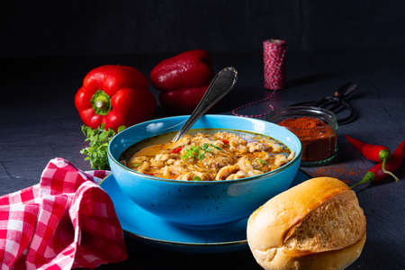 flaczki - fresh and spicy tripe soup with herbs Stockfoto