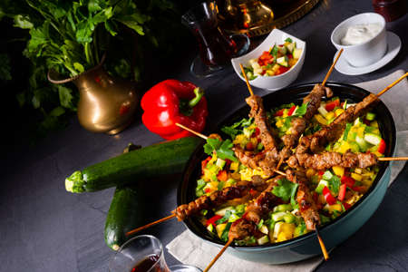 Lamb skewers with curry rice and different vegetables Reklamní fotografie - 131577085