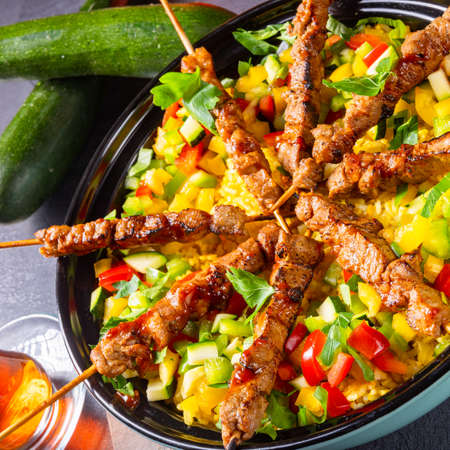 Lamb skewers with curry rice and different vegetables Reklamní fotografie - 131577094