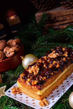 Chocolate gingerbread with filling, jam and nuts Stock Photo