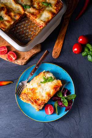 spicy lasagne with tomato sauce and basil 写真素材