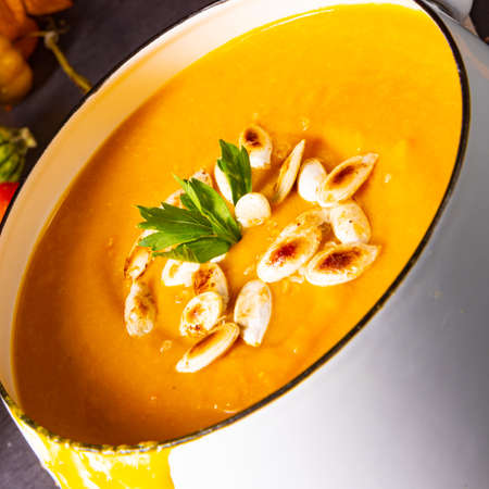 Pumpkin cream soup with roasted pumpkin seeds and seed oil Stock Photo