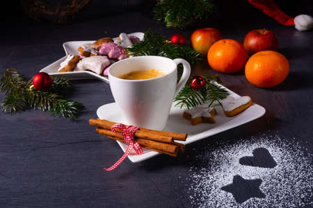Hot chocolate with colorful christmas biscuits