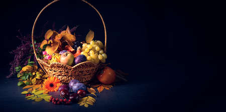 autumnal cornucopia in round basket Stock Photo