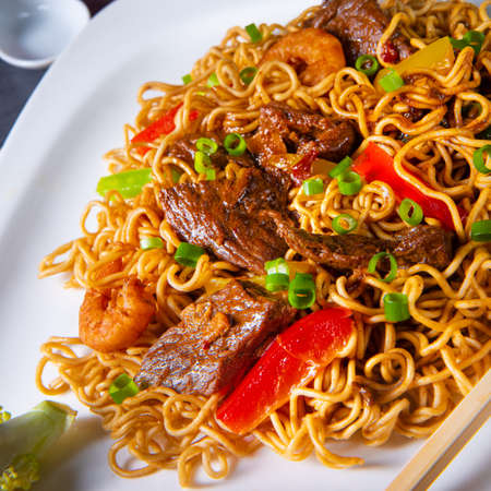 Fried Mie noodles with beef and vegetables. Stock Photo