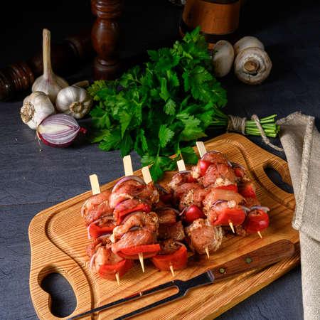 raw shish kebab with various vegetables Stock Photo