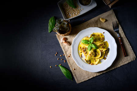 Vegetariano italiano! Tortellini with roasted pine nuts and pesto basilico