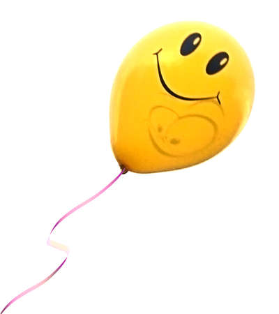 Yellow baloon with a happy smile on it, isolated