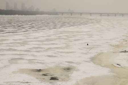 dnepr: Frozen river Dnepr and view of a misty Ukrainian capital Kyiv (Kiev)