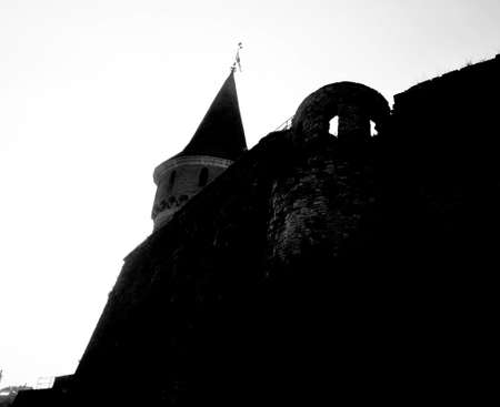 fortification: Castle wall and tower midevil fortification black and white silhouette