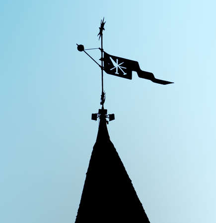 castle conditioning: Weather vane with a flag and an emblem, standing on one of the European medieval fortresses