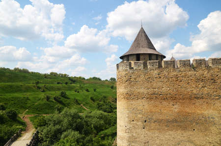 teutonic: Medieval castle standing over a green summer field Stock Photo
