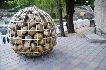 gravitation: Basket with stones monument in Kamianets-Podolsky city, Ukraine