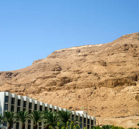 judaean desert: Sights for pilgrims in Israel - scenic Judean desert mountains with hotels and resorts, tourism in Israel