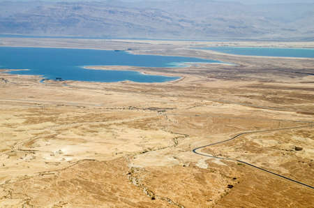 judean hills: Mountains, rocks and hills of Judean desert in Israel, Middle East landmarks of Old Testament Bible times. Aerial view of Dead sea spa and recreation areas