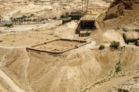 judaean: Ruins of ancient Roman fortifications near Masada fortress in Israel. Judean desert landmarks for tourists traveling to Middle East