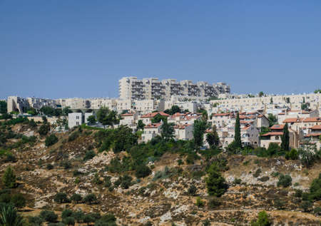 tora: Gehenna Hinnom Valley and residential buildings in Old part of Jerusalem. Hell mouth or hellfire place in religious manuscripts, Bible and Tora Stock Photo
