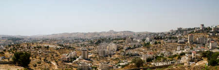 Panorama of Bethlehem with Herodium Herodion hill at the background. Landmarks for tourists of Israel and Palestine, holy and historic places