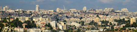the holy land: Jerusalem panorama view, modern Middle east cityscape architecture with construction cranes. Holy land contemporary buildings