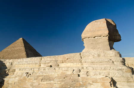 gods: Sphinx and Great pyramiid of Giza in Egypt. Gods of Egypt in stone and bricks