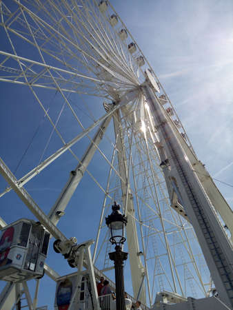 ferriswheel: Cabins of La Grande Roue, Ferris wheel in Paris, France, perspective view of a big observation wheel