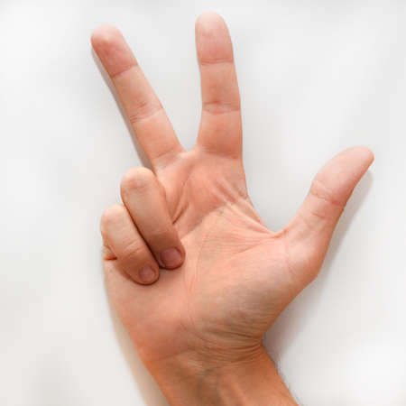 dactylology: Number three in the American Sign Language (ASL) as it is shown with hand and fingers