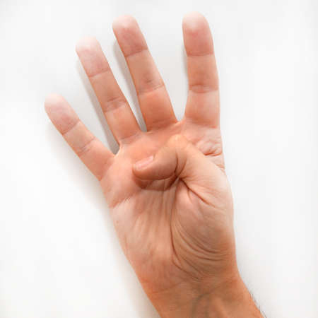 dactylology: Number four in the American Sign Language (ASL) shown with one hand and a finger