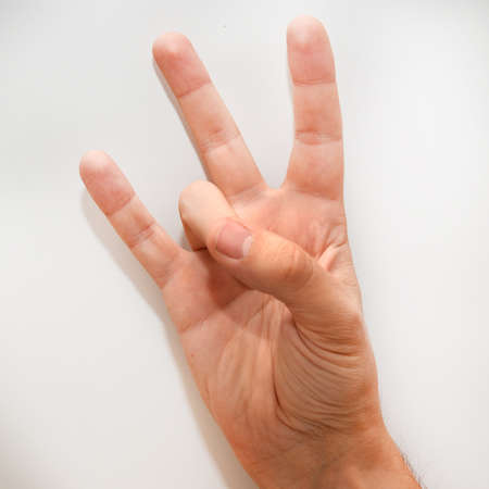 dactylology: Number seven in the American Sign Language (ASL) shown with one hand and fingers Stock Photo