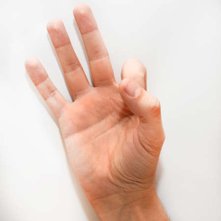 dactylology: Number nine in the American Sign Language (ASL) as it is shown with one hand and fingers