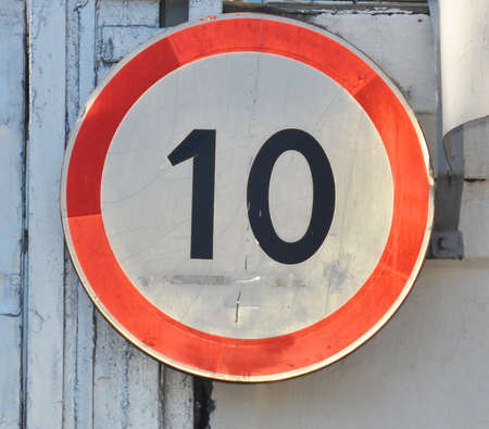 restricting: Old traffic sign restricting speed to 10 kilometers per hour Stock Photo