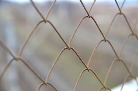 Old rusty  chain link grid fence close view, prison concept