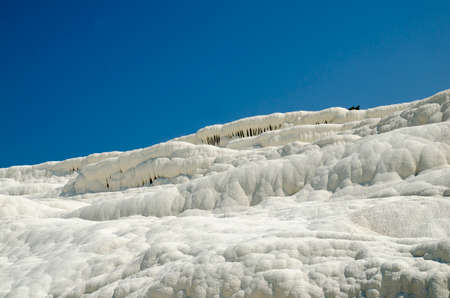 natural formation: Snow white mountains of Pamukkale, Turkey. Natural salt hills background Stock Photo