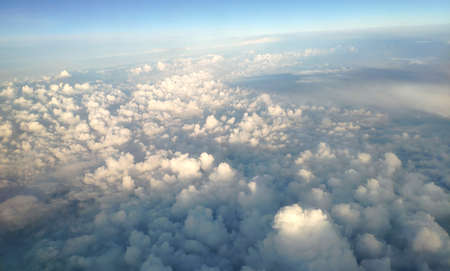 Clouds as they are seen from airplane, sky with clouds background, amazing flight over fluffy clouds Banque d'images