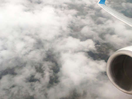 Clouds as they are seen from airplane, sky with clouds background, amazing flight over fluffy clouds Фото со стока
