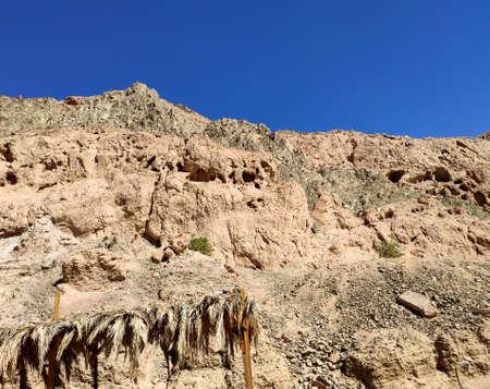 Sinai desert rocks and mountains background, mountain landscape wallpaper, picturesque view. Bedouin village remnants
