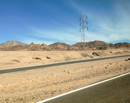 Road in the Sinai desert, picturesque background with mountains and hills, desert landscape wallpaper
