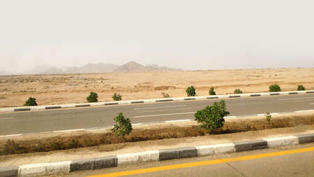 Road in the Sinai desert, Sharm el Sheikh road through the city and the desert. Urban landscape in Egypt Archivio Fotografico
