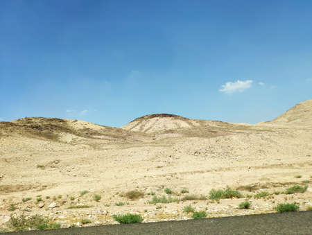 Desert land landscape with rocks, hills and mountains background, Negev desert in Israel, nice touristic location Фото со стока