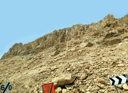 Desert rocks and hills background, Negev desert in Israel with traffic signs, nice touristic location Фото со стока