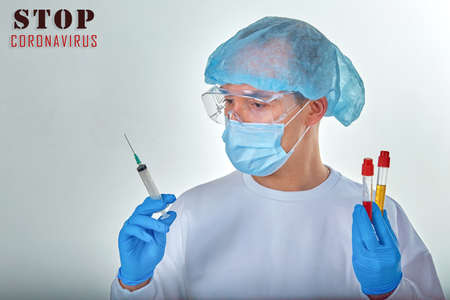 Doctor in mask performing blood test for coronavirus COVID19, HIV, ebola or other dangerous infection. Medical background, template, wallpaper. Coronavirus disease concept