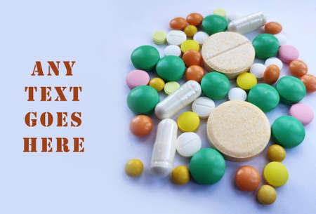 Stack of colorful pills, medicine background. Tablets prescribed for different diseases, health care background, colored pills. Medical conceptual photo background Stock fotó