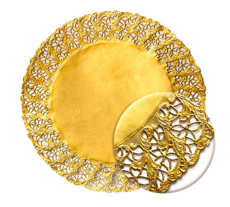 Golden confectionery napkin with decorative texture under magnifying glass. Delicate napkin isolated over white background