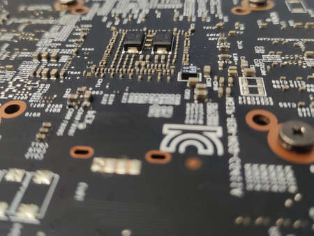 Computer engineering microchip blurred background. Microelectronic high tech wallpaper. Motherboard hardware, electronics conceptual photography Banco de Imagens