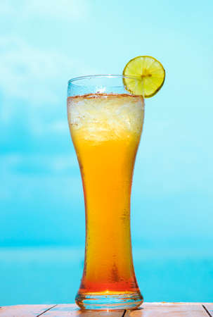 glass of ice tea on tropical background Stock Photo