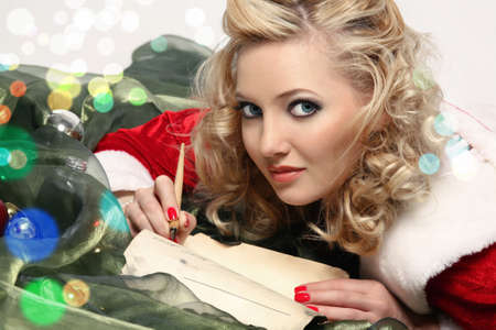Charming blonde writes a letter to Santa Claus 写真素材