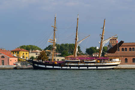 sailing ship moored to the bank of Venice     photo